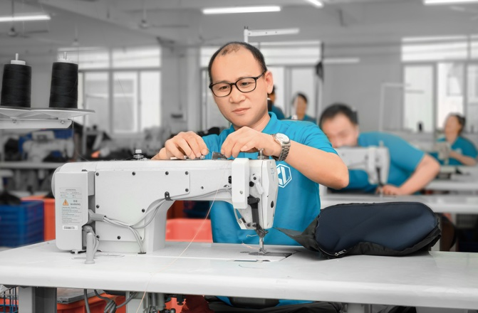 skilled workers saw the fabrics by machine
