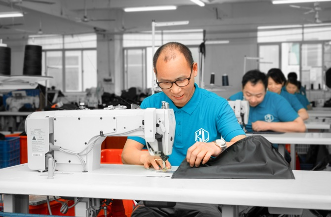 skilled workers manufacture bags efficently by machines